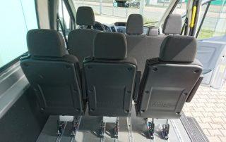 Transit GT 9 Sitzer plus Rollstuhl - Mietwagen Behindertengerecht